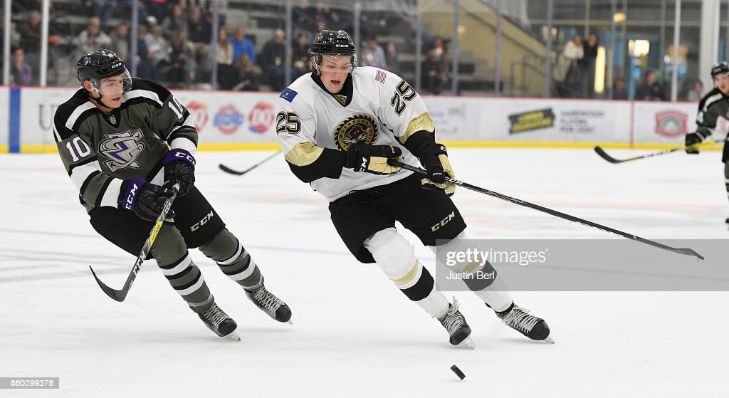 Jachym Kondelik #25 of the Muskegon Lumberjacks goes for a loose puck against Jace Foskey #10 of the Tri-City Storm during the game on Day 3 of the USHL Fall Classic at UPMC Lemieux Sports Complex on September 30, 2017 in Cranberry Township, Pennsylvania.