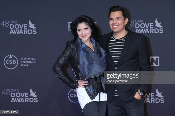 Jaci Velasquez and husband Nic Gonzales arrives at the 48th Annual GMA Dove Awards red carpet at Allen Arena on October 17 2017 in Nashville TN