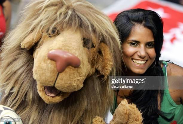 Jaciara da Souza wife of portuguese player Anderson 'Deco' de Souza poses with mascot 'Goleo' prior to the semi final match of the 2006 FIFA World...