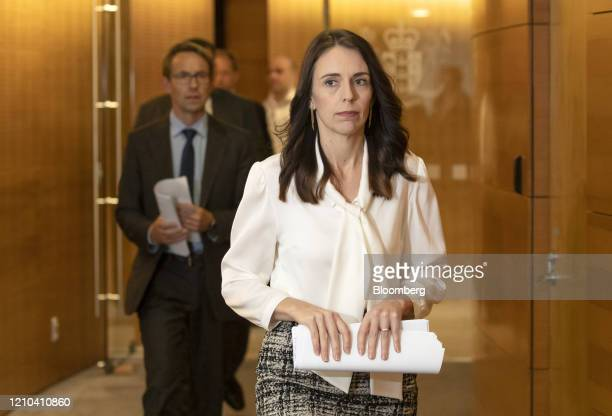 Jacinda Ardern New Zealand's prime minister center right and Ashley Bloomfield director general of health arrive for a news conference at the...