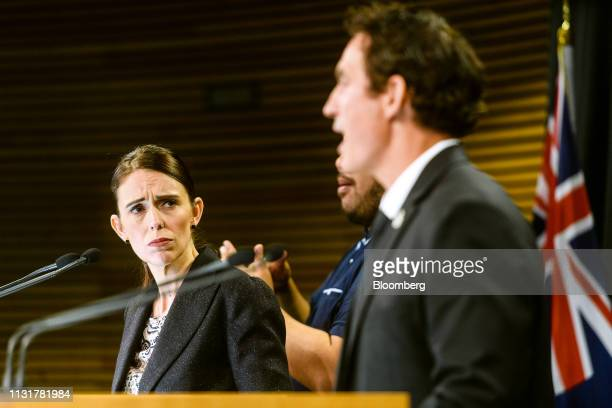 Jacinda Ardern, New Zealand's prime minister, left, looks on as Stuart Nash, New Zealand's minister of police, revenue, fisheries and small business,...