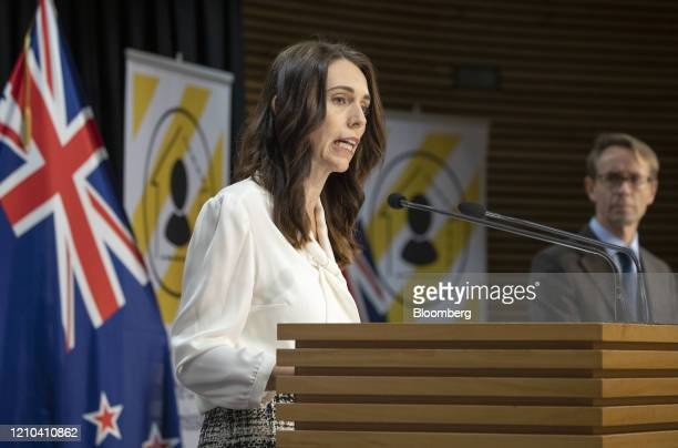 Jacinda Ardern New Zealand's prime minister left speaks as Ashley Bloomfield director general of health listens during a news conference at the...