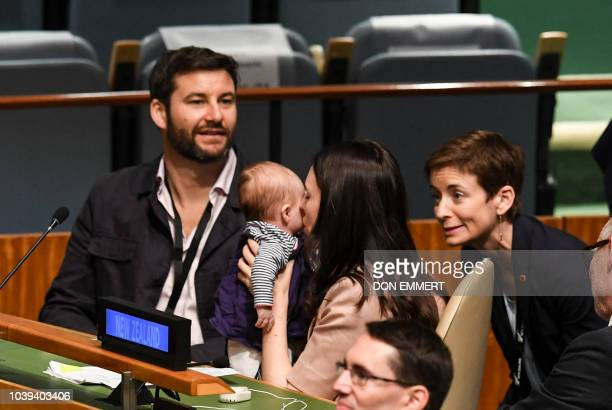 Jacinda Ardern Prime Minister and Minister for Arts Culture and Heritage and National Security and Intelligence of New Zealand kisses her daughter...