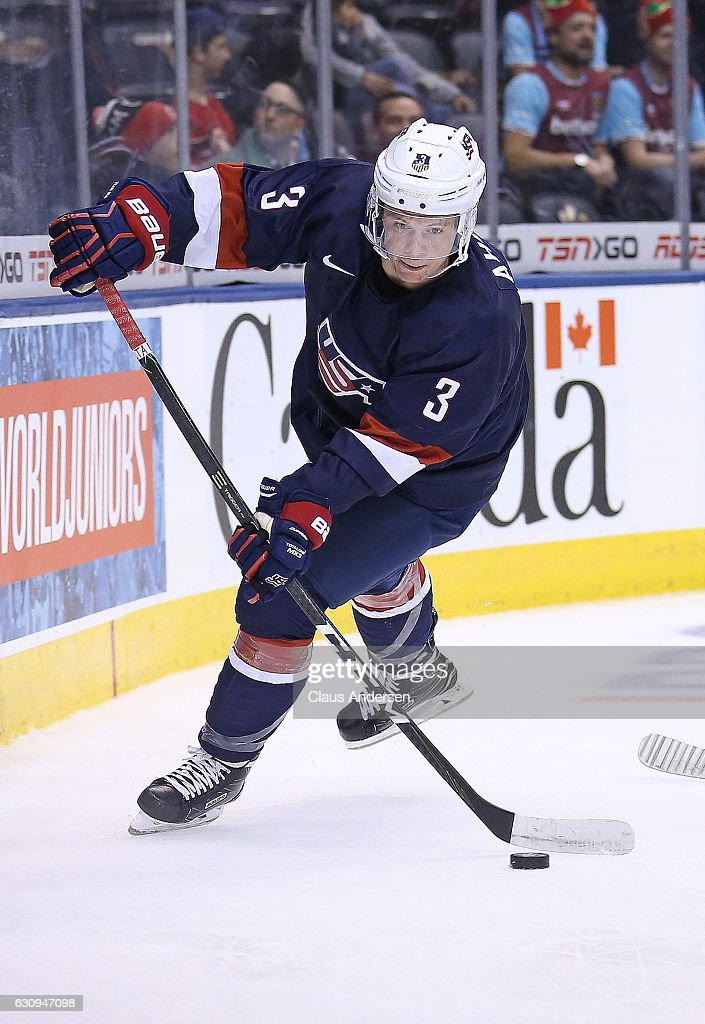 Jack Ahcan #3 of Team USA gets set to pass a puck forward against Team Latvia during a preliminary game at the 2017 IIHF World Junior Hockey Championship at the Air Canada Centre on December 26, 2016 in Toronto, Ontario, Canada. USA defeated Latvia 6-1.