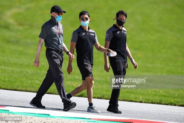 Jack Aitken of Great Britain and Campos Racing walks the track with his team during previews for the Formula 2 Championship at Red Bull Ring on July...