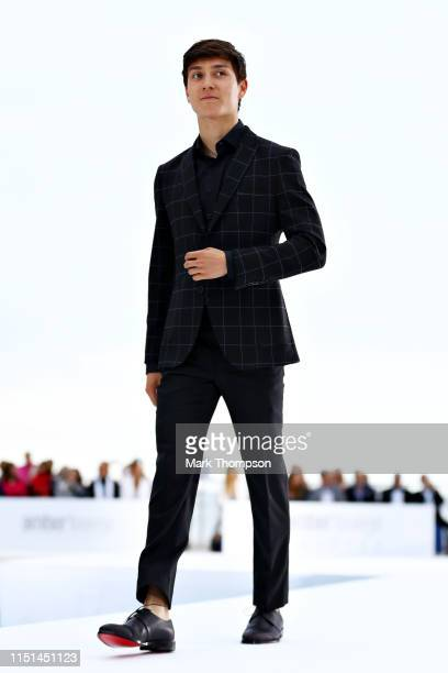 Jack Aitken of Great Britain and Renault Sport F1 walks in the Amber Lounge Fashion Show during previews ahead of the F1 Grand Prix of Monaco at...