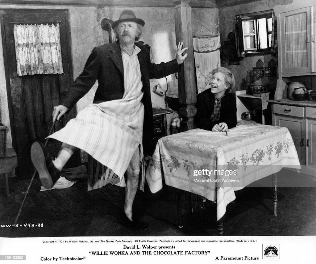 Jack Albertson dancing in front of Peter Ostrum in a scene from the film 'Willy Wonka & the Chocolate Factory', 1971.
