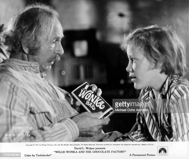 Jack Albertson showing Peter Ostrum a Wonka bar in a scene from the film 'Willie Wonka And The Chocolate Factory' 1971
