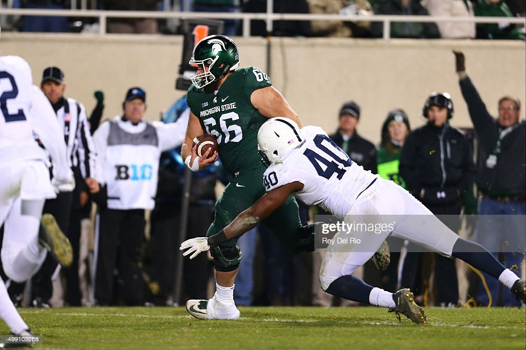 Jack Allen #66 of the Michigan State Spartans runs the ball and scores a touchdown in the fourth quarter against the Penn State Nittany Lions at Spartan Stadium on November 28, 2015 in East Lansing, Michigan.