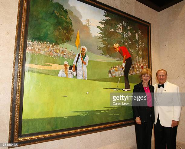 Jack and Barbara Nicklaus pose by an oil painting of himself by Dallas illustrator Bart Forbes in the new clubhouse during of THE PLAYERS...