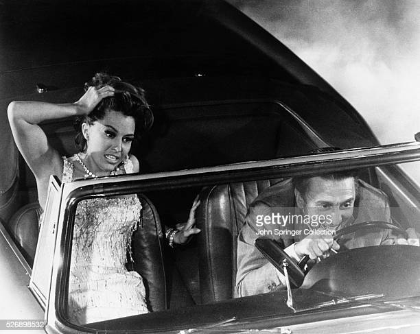 Jack Andrus drives recklessly while his exwife Carlotta panics beside him