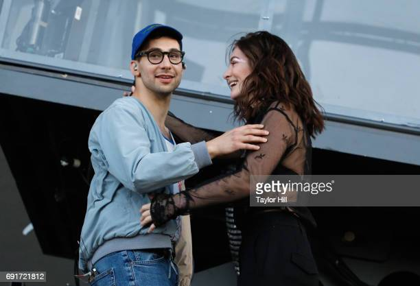 Jack Antonoff and Lorde speak onstage during 2017 Governors Ball Music Festival Day 1 at Randall's Island on June 2 2017 in New York City
