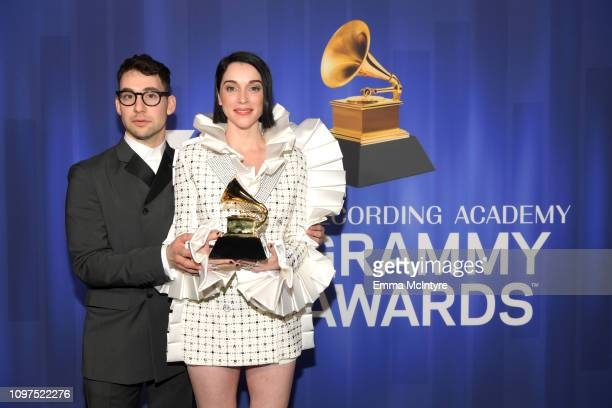 Jack Antonoff and St. Vincent pose with their award at 61st Annual GRAMMY Awards Premiere Ceremony at Microsoft Theater on February 10, 2019 in Los...