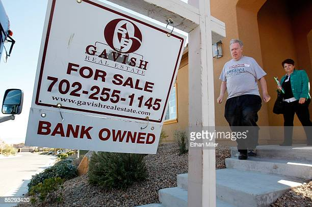 Jack Arnold of Nevada and RE/MAX Central realtor Mary Kennedy leave a bankowned house during a tour of foreclosed homes March 7 2009 in Las Vegas...