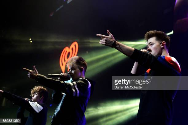 Jack Avery Corbyn Besson and Zach Herron of Why Don't We perform onstage during KISS 108's Jingle Ball 2017 presented by Capital One at TD Garden on...