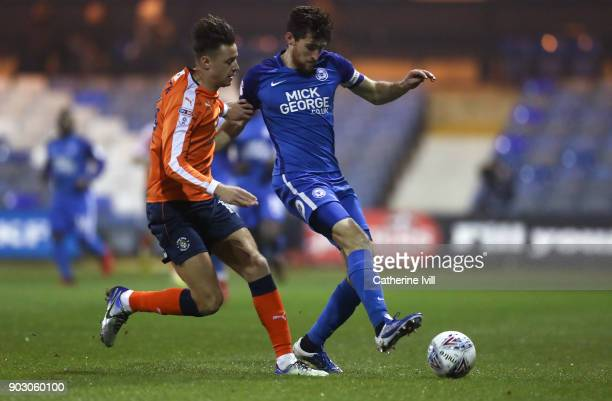 Jack Baldwin of Peterborough United battles with Harry Conick of Luton Town during the EFL Checkatrade Trophy Third Round match between Luton Town...