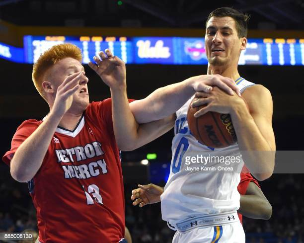 Jack Ballantyne of the Detroit Mercy Titans and Alex Olesinski of the UCLA Bruins battle for a rebound in the first half of the game against at...