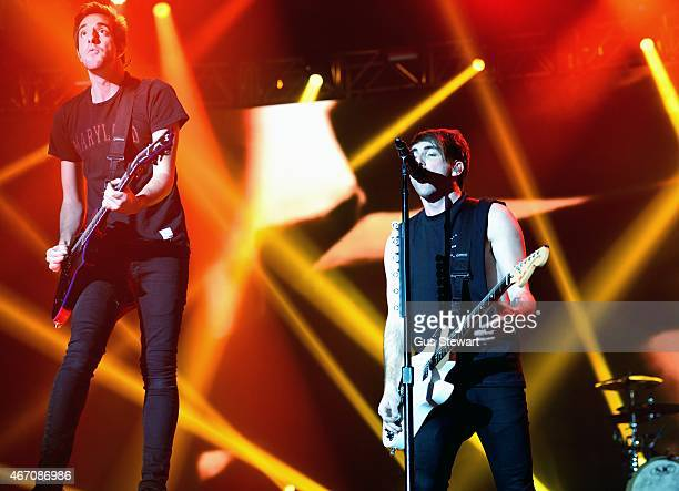 Jack Barakat and Alex Gaskarth of All Time Low perform on stage at Wembley Arena on March 20 2015 in London United Kingdom