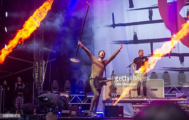 Jack Barakat and Bryan Donahuem of All Time Low perform onstage headlining during day 1 of Download Festival at Donnington Park on June 10 2016 in...
