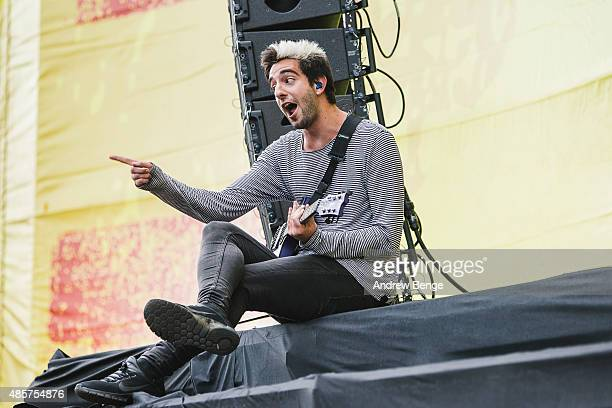 Jack Barakat of All Time Low performs on the main stage at Leeds Festival at Bramham Park on August 29 2015 in Leeds England