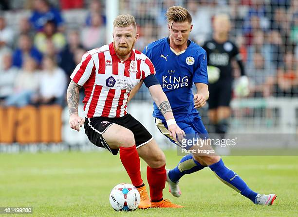 Jack Barmby of Leicester City in action with Alan Power of Lincoln City during the preseason friendly between Lincoln City and Leicester City at...