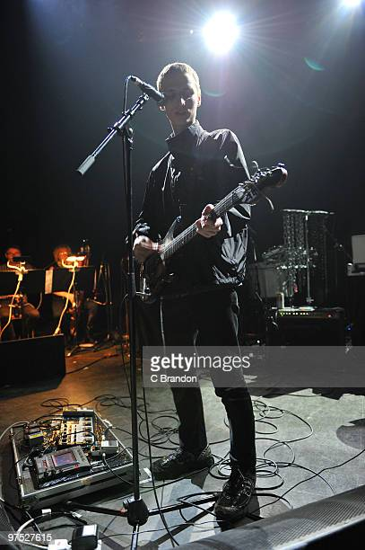Jack Barnatt of These New Puritans performs on stage at Shepherds Bush Empire on March 2 2010 in London England A large bank of guitar effects pedals...