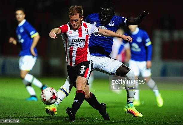 Jack Barthram of Cheltenham Town is tackled by Oumar Niasse of Everton during the EFL Checkatrade Trophy match between Cheltenham Town and Everton at...