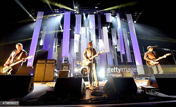 """Jack Bates, Jimmy Chamberlin, Billy Corgan and Jeff Schroeder of The Smashing Pumpkins perform onstage during the """"The End Times Tour"""" opener at..."""
