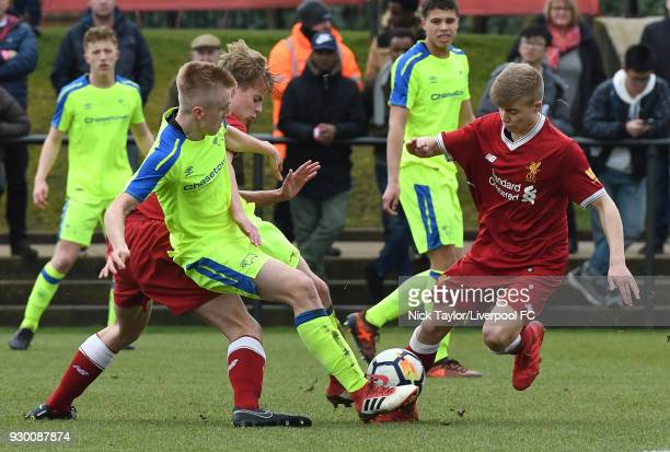 Jack Bearne of Liverpool and Louie Sibley of Derby County in action during the U18 Premier League match between Liverpool and Derby County at The...