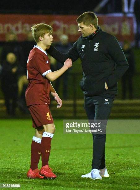 Jack Bearne of Liverpool with Steven Gerrard after the Liverpool v Stoke City U18 Premier League game at The Kirkby Academy on February 2 2018 in...