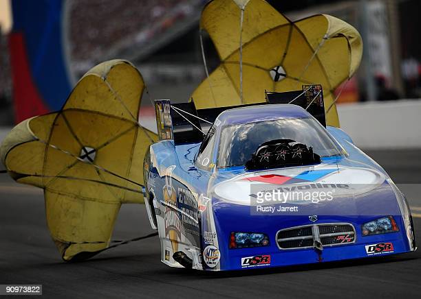 Jack Beckman driver of the Valvoline funny car drives during qualifying for the NHRA Carolinas Nationals on September 19 2009 at Zmax Dragway in...