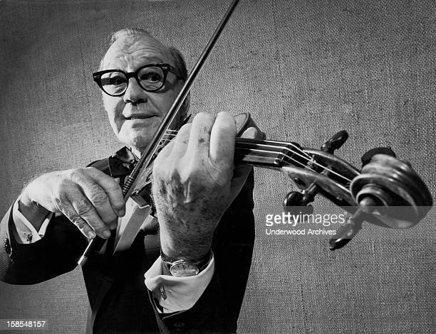 Jack Benny playing the violin in 'Jack Benny's First Farewell' production celebrating his fifty years of entertaining New York New York 1973