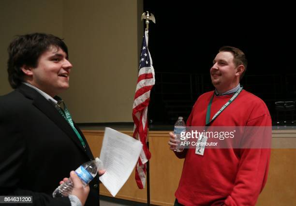 Jack Bergeson of Wichita Kansas talks with fellow candidate Ethan Randleas of Wichita before a forum with the four teenage candidates for Kansas...
