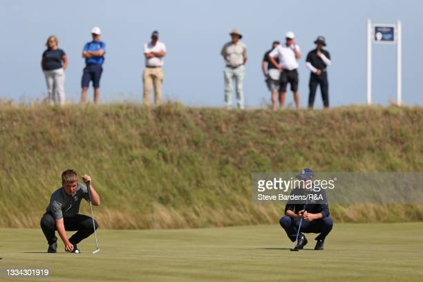 Jack Bigham of Harpenden and Riccardo Fantinelli of Italy line up their putts on the 8th green during the Final of the R&A Boys Amateur Championship...