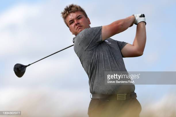 Jack Bigham of Harpenden drives off the 14th tee during the Final of the R&A Boys Amateur Championship at Royal Cinque Ports Golf Club on August 15,...
