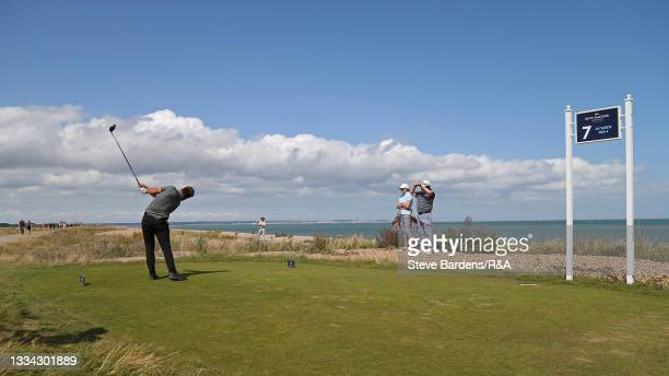 Jack Bigham of Harpenden drives off the 7th tee during the Final of the R&A Boys Amateur Championship at Royal Cinque Ports Golf Club on August 15,...