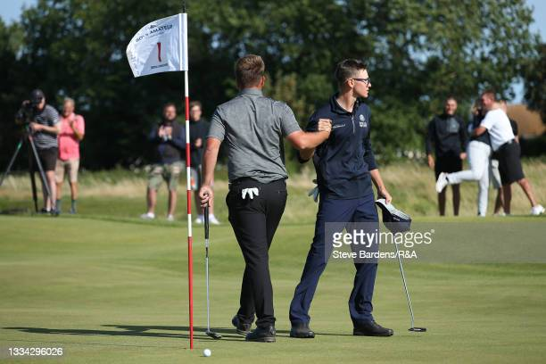 Jack Bigham of Harpenden is congratulated bf Riccardo Fantinelli of Italy after his victory on the 19th green during the Final of the R&A Boys...