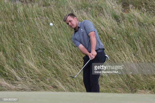 Jack Bigham of Harpenden plays a chip shot onto the 10th green during the Final of the R&A Boys Amateur Championship at Royal Cinque Ports Golf Club...