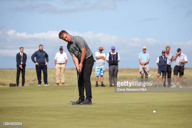 Jack Bigham of Harpenden putts on the 13th green during the Final of the R&A Boys Amateur Championship at Royal Cinque Ports Golf Club on August 15,...