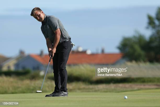 Jack Bigham of Harpenden putts on the 18th green to tie the match and take it to the 19th hole during the Final of the R&A Boys Amateur Championship...