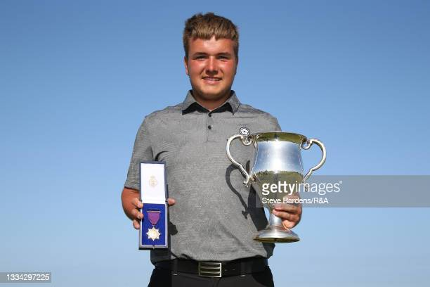 Jack Bigham of Harpenden with the R&A Boys Amateur Championship trophy and winners gold medal after his victory in the Final of the R&A Boys Amateur...