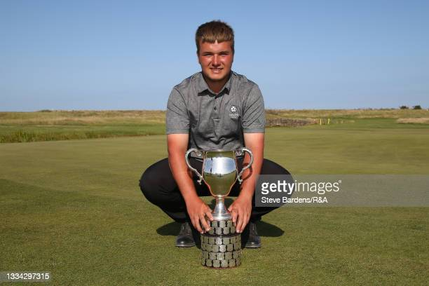 Jack Bigham of Harpenden with the R&A Boys Amateur Championship trophy after his victory in the Final of the R&A Boys Amateur Championship at Royal...