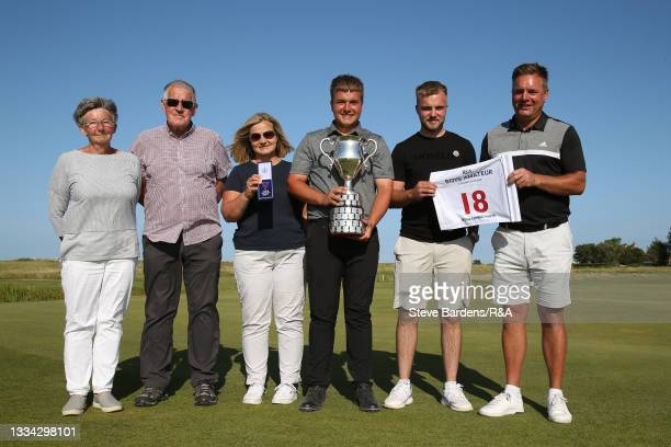 Jack Bigham of Harpenden with the R&A Boys Amateur Championship trophy and family members after his victory in the Final of the R&A Boys Amateur...