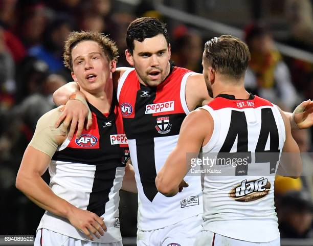 Jack Billings is congratulated by Paddy McCartin and Maverick Weller of the Saints after kicking a goal during the round 12 AFL match between the...