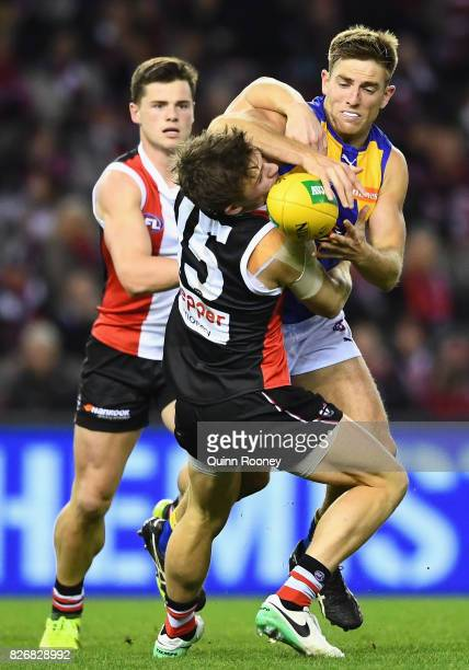 Jack Billings of the Saints and Brad Sheppard of the Eagles compete for the ball during the round 20 AFL match between the St Kilda Saints and the...