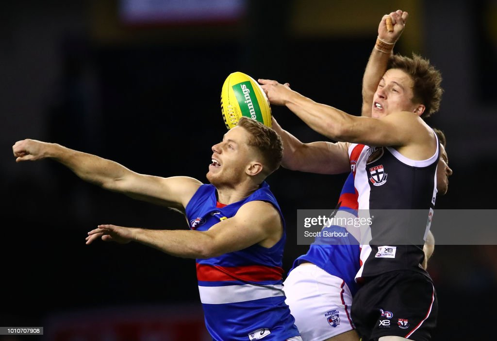 Jack Billings of the Saints and Lachie Hunter of the Bulldogs compete for the ball during the round 20 AFL match between the St Kilda Saints and the Western Bulldogs at Etihad Stadium on August 4, 2018 in Melbourne, Australia.
