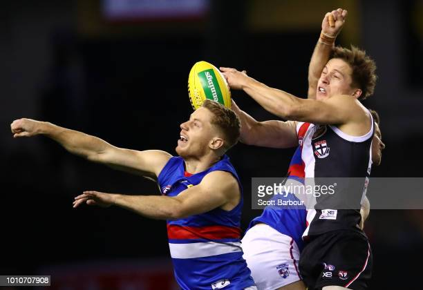 Jack Billings of the Saints and Lachie Hunter of the Bulldogs compete for the ball during the round 20 AFL match between the St Kilda Saints and the...