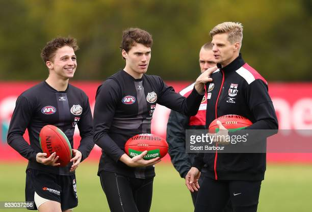 Jack Billings of the Saints Blake Acres of the Saints and Nick Riewoldt of the Saints talk during a St Kilda Saints AFL training session at Linen...