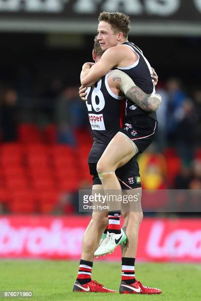 Jack Billings of the Saints celebrates winning the round 13 AFL match between the Gold Coast Suns and the St Kilda Saints at Metricon Stadium on June...