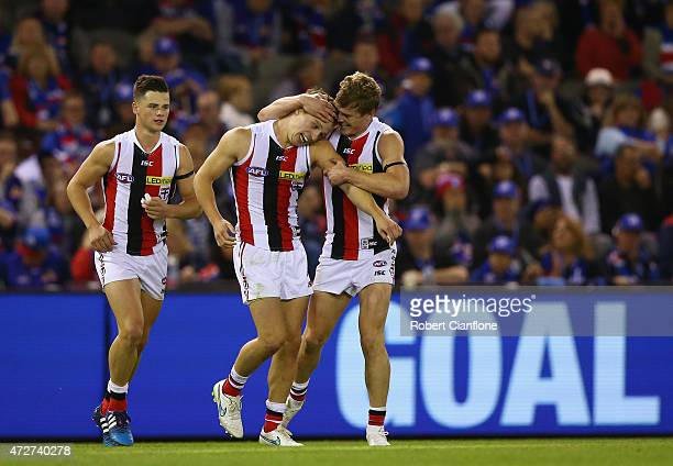 Jack Billings of the Saints celebrates with team mates after scoring a goal during the round six AFL match between the Western Bulldogs and the St...